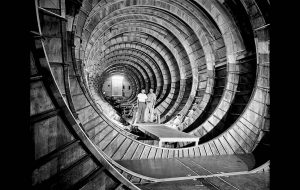 July 16, 1945: Two workmen stand in the interior of the hull of the Hughes Hercules seaplane which will have a cargo space equivalent to that of two railroad boxcars when it is completed at the Hughes Aircraft company plant in Culver City. The aircraft is now known as the Spruce Goose.